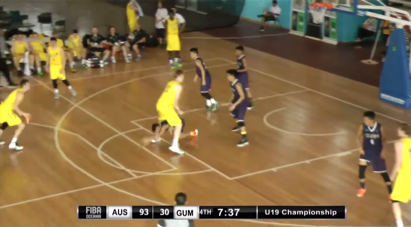 Guam Player Through Defenders Legs